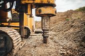 Rotary Drills, Bulldozer And Excavator Working On Highway Construction Site With Heavy Duty Machiner poster
