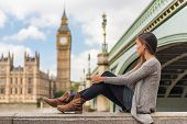 London young woman relaxing pensive thinking alone at Big Ben tower in urban Europe city. Asian girl poster