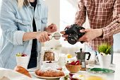 Food-photographer and food-stylist producing food advert poster