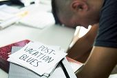 closeup of a concerned man sitting at his office desk and a note in the foreground with the text pos poster