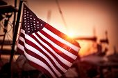 Flag of United States of America flutters in the winds in mild sunset light, independence day of Ame poster