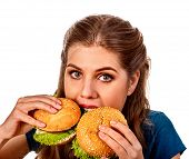 Woman eating two hamburgers. Student consume fast food. Girl bite of two small burgers. Girl trying  poster
