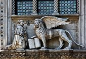 stock photo of porphyry  - The Venetian lion and Doge on a cathedral building on San Marco square - JPG