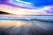 Small Ocean Sea Waves On Sandy Beach With Sunrise Sunset. poster