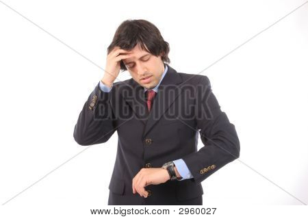 Worried Businessman Consulting His Watch