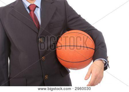 Business Man Holding Basketball Ball