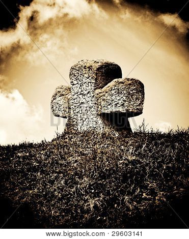 stone cross at the ancient tomb