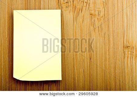 blank sticker glued to a bamboo board