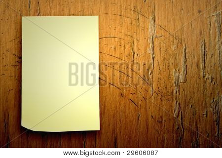 blank sticker glued to a wood board