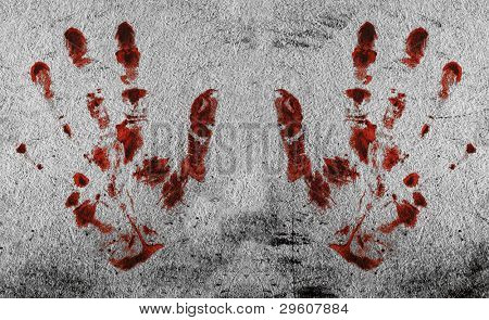 Grunge background with a print of a bloody hands