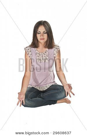 Beautiful Young Girl Meditating on a white background