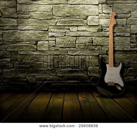 grunge interior with electric guitar and lighting effects