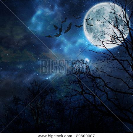 Halloween background. Bats flying in the night with a full moon in the background.