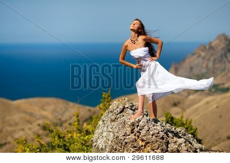 beauty woman on the rock in white tissue
