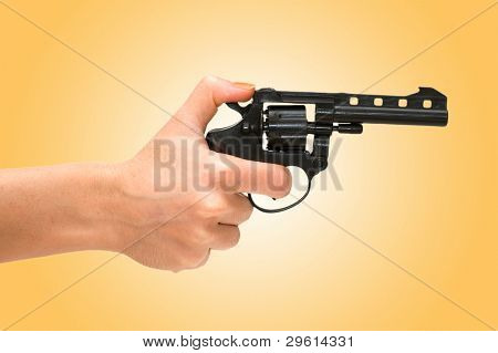 Hand holding revolver isolated on the white