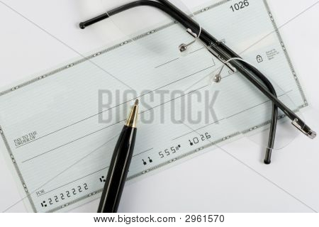 Blank Check With Glasses And Pen