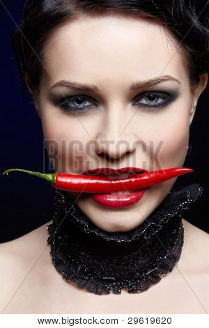 Beautiful Brunette With Red Chilli Pepper