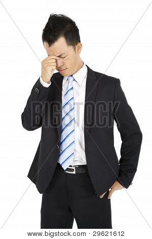 Businessman with headache and depression feeling upset