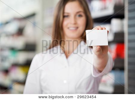 Female pharmacist advising to prefer prescribed medicine