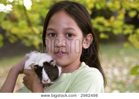 Child With Guinea Pigs