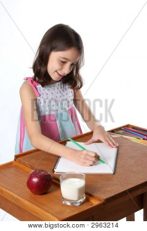 Young Girl / Child Drawing With Pencils