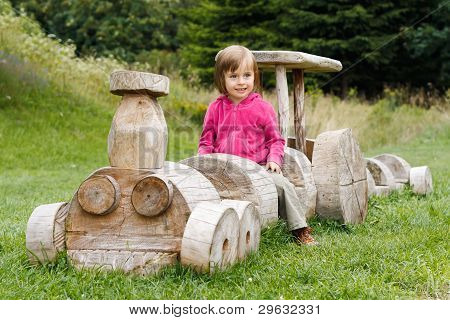 Cute Girl On A Wooden Train