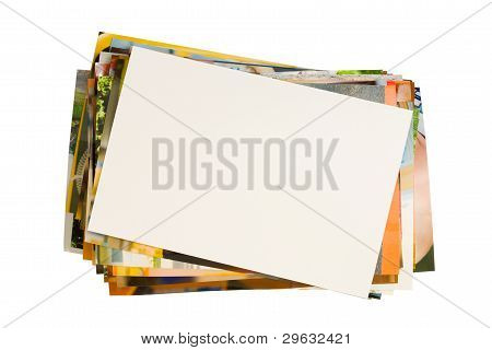 Pile Of Photographs With Empty Frame