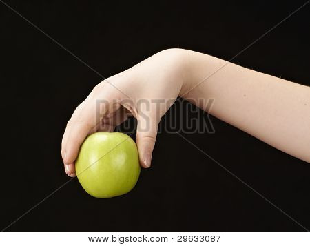 Childs hand with apple