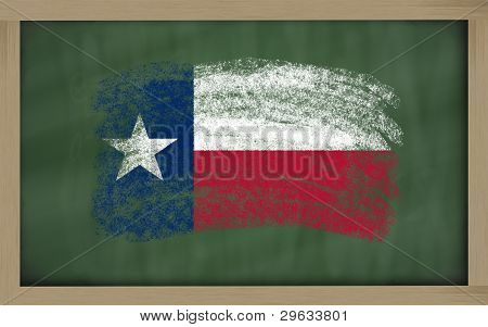 Flag Of Us State Of Texas On Blackboard Painted With Chalk