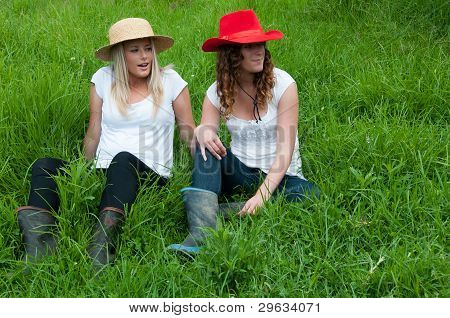 Girls relaxing in a paddock on a farm