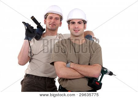 Two manual workers with drills