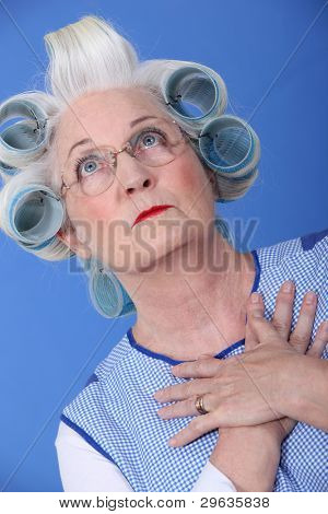 Elderly woman with her hair in rollers
