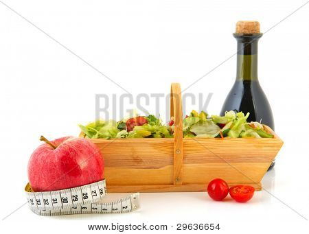 Fresh mixed healthy salad isolated over white background