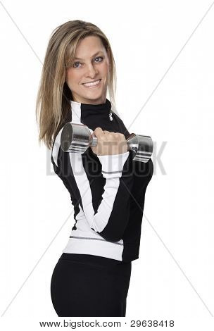 Pretty 40 year old woman holding dumbbell on white background.