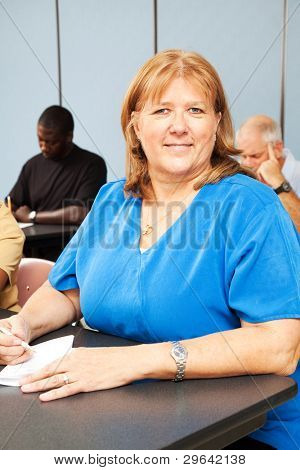 Mature woman in diverse adult education class