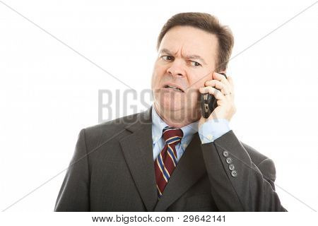 Businessman talking on his cellphone.  Very expressive worried face.  Isolated on white.