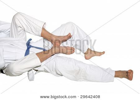 Judo Fighters Wrestling For Supremacy On The White Background