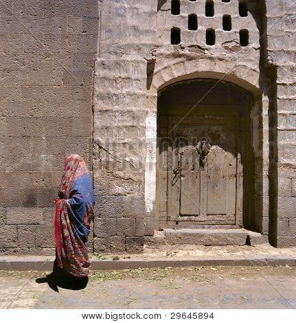 A Veiled Muslim Woman Walks On A Sana'a Street, Yemen