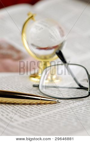 Newspaper, Pen, Glasses  And Globe