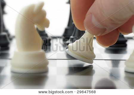 Pawn In Hands Over A Chessboard