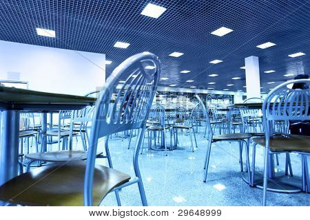 Modern interior of restaurant toned in blue color