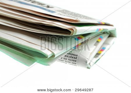 Newspaper close-up isolated over the white background