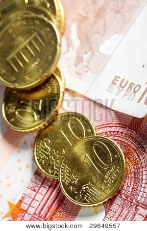 Heap of euro cent coins close up on banknote