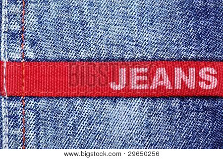 """Blue jeans and red label with word """"Jeans"""""""