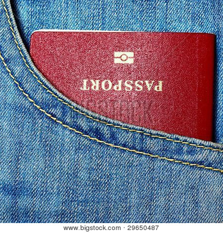 Red biometric passport in pocket