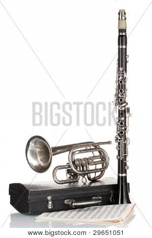 antique trumpet, clarinet and case isolated on white