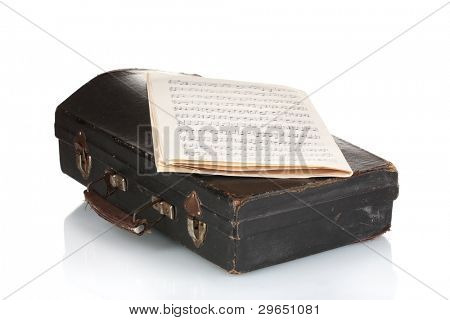 old case for musical instrument and notebook with notesisolated on white