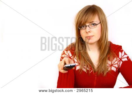 Portrait Of Attractive Beautiful Young Woman On Couch With Remote