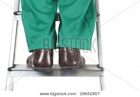 Feet Of Worker On Ladder