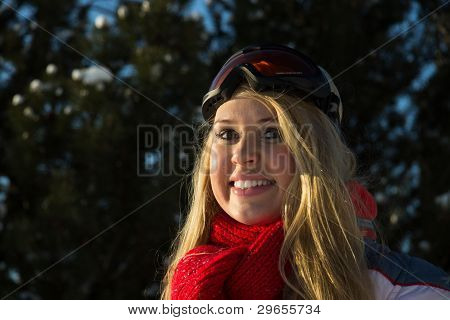 Portrait Of A Woman In Winter Sport Wear Smiling At Camera